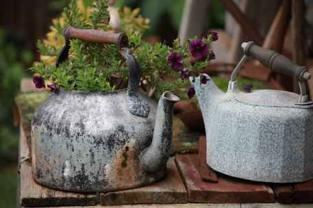 two gray kettles on table